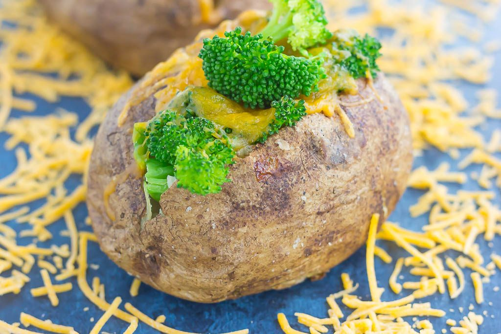 """Seasoned potatoes are baked until soft and fluffy on the inside and crisp on the outside. Topped with fresh broccoli and a sprinkling of cheddar cheese, these Broccoli Cheddar Stuffed Baked Potatoes make deliciously easy """"meal for one"""" that's packed with flavor!"""