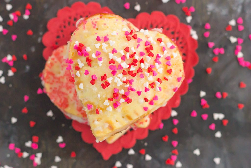 These Mini Strawberry Heart Pies are the perfect dessert for spoiling your sweetie on Valentine's Day or for entertaining those party guests. A pre-made pie crust is cut into the shape of hearts and then filled with sweet strawberry jam. It's an impressive treat that looks time-consuming but is so easy to make!