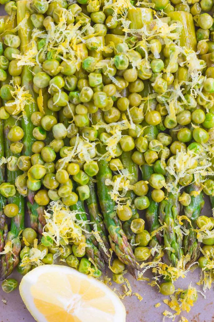 Roasted Asparagus and Peas with Lemon is an easy side dish that's bursting with flavor. Fresh asparagus and peas are drizzled with olive oil, roasted until tender, and then topped with a lemon zest mixture. Simple, fresh, and delicious, this will become your new favorite way to eat your veggies!