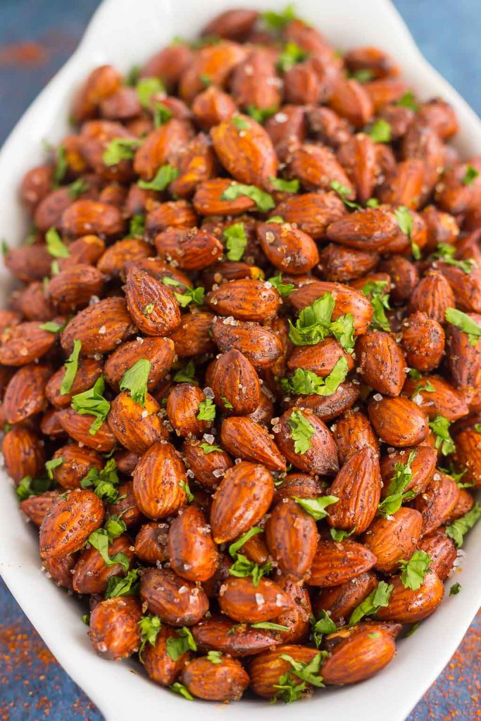 These Easy Chili Almonds are a simple snack that's packed with deliciousness. Roasted in a skillet and tossed with zesty flavors, these almonds are perfect for those snack cravings!