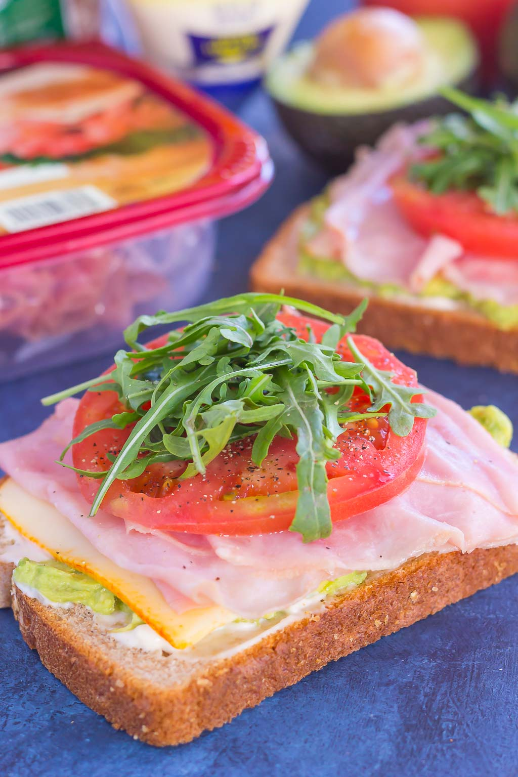 This Ham and Avocado Open-Faced Sandwich is simple, fresh, and perfect for a light lunch or dinner. Honey ham and tangy cheese is piled high on a slice of thick bread, then garnished with mayonnaise, avocado, and fresh tomato. With just six ingredients and hardly any prep time involved, you can have this easy sandwich ready in no time!