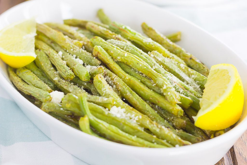 These Roasted Lemon Garlic Green Beans are a simple side dish that's packed with flavor. Crispy on the outside, tender on the inside, and loaded with a lemon garlic zest, this dish pairs perfectly with just about anything!