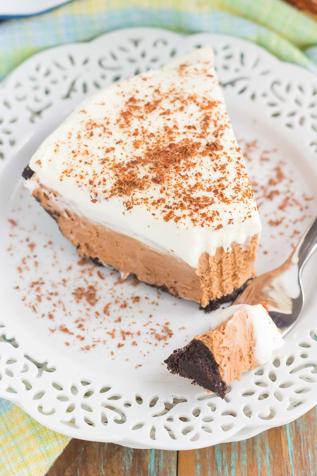 This Chocolate Nutella Cream Pie is filled with a smooth and creamy base of nutella, enveloped in a chocolate cookie crust and topped with homemade whipped cream. Easy to make and ready in no time, this decadent dessert is perfect for impressing dessert lovers everywhere!