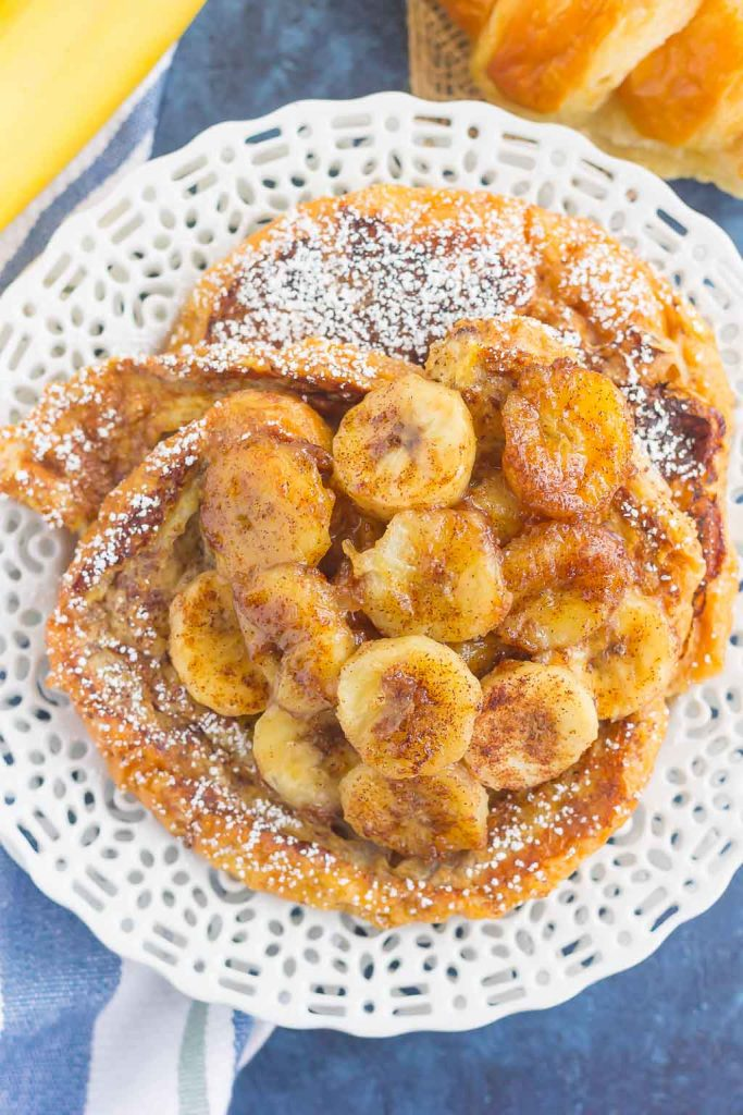 This Cinnamon Banana Croissant French Toast features thick slices of flaky, buttery croissants that are sprinkled with a cinnamon mixture and topped with caramelized bananas. Simple, fresh, and bursting with a rich flavor, this is the perfect way to switch up your french toast routine!