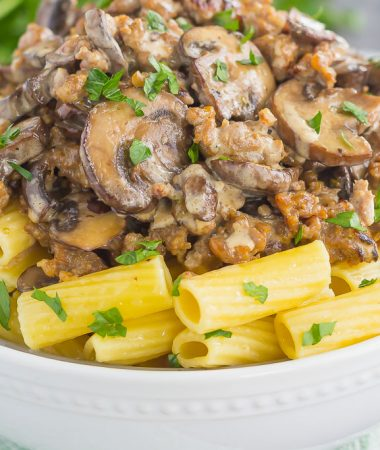 This Creamy Sausage and Mushroom Rigatoni is the perfect comfort dish that's ready in just 30 minutes. Zesty sausage, fresh mushrooms and rigatoni pasta are tossed in flavorful cream sauce. Hearty, comforting, and all-around delicious, this meal-time favorite is sure to be a winner all year long!