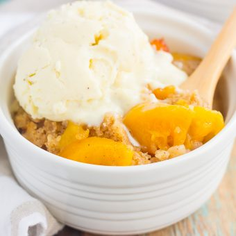 This Slow Cooker Peach Cobbler is loaded with juicy peaches, a sprinkling of cozy spices, and layered with a crispy, cakey topping. Just throw everything into the slow cooker, set it, and forget it. In just a few hours, you'll have a warm and flavorful dessert ready to be devoured!