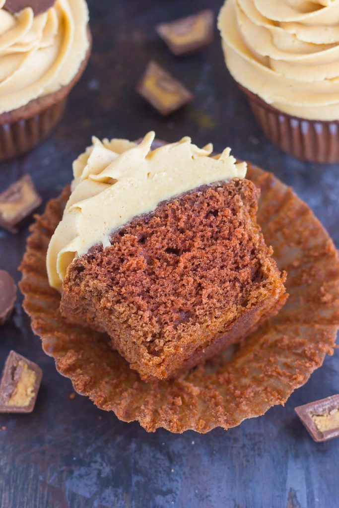 These Chocolate Cupcakes with Peanut Butter Frosting are a deliciously sweet dessert for everyone to enjoy. If you're a fan of chocolate and peanut butter, you'll love the rich and fluffy cupcakes that are piled high with a creamy and silky frosting!
