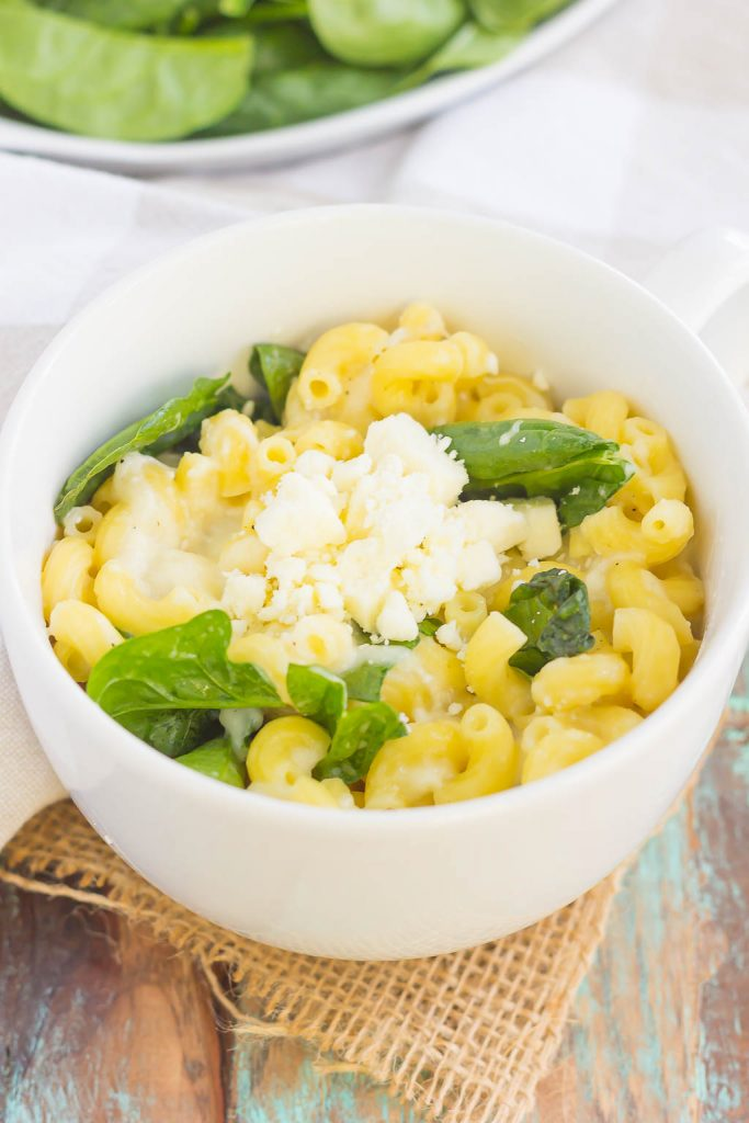 All it takes is just one mug and 5 minutes to make this Microwave Mug Spinach and Feta Macaroni and Cheese. Tender pasta, mozzarella and feta cheeses and a sprinkling of spinach create an easy, cheesy, and oh-so delicious single serving recipe for the best macaroni and cheese!