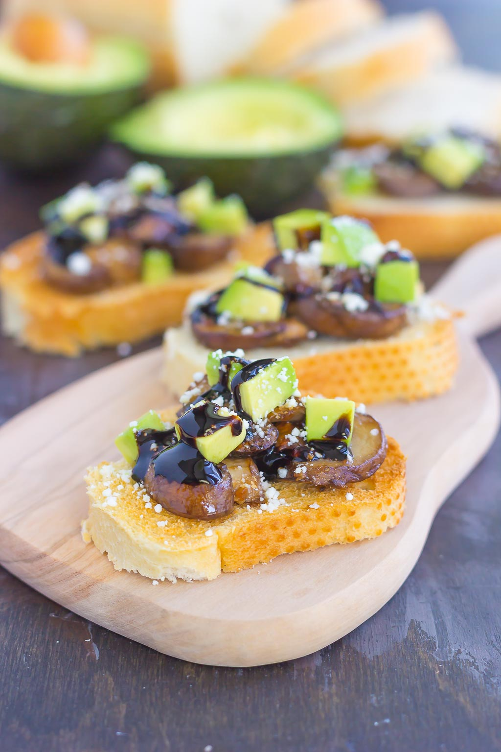 This Mushroom, Avocado and Feta Toast combines fresh mushrooms, ripe avocado and creamy feta cheese, piled high on toasted bread and drizzled with a balsamic glaze. This simple toast makes a deliciously easy appetizer or side dish!