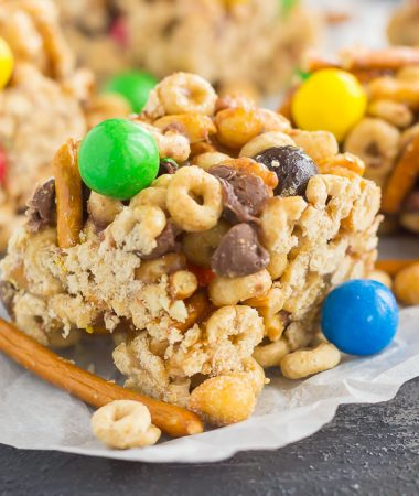 These No-Bake Sweet and Salty Cereal Bars are perfect for when those cravings strike. Filled with Honey Nut Cheerios, honey roasted peanuts, pretzels, and chocolate candies, these bars are the perfect combination of sweet and salty. With no oven required and minimal ingredients, you can have these bars prepped and ready to be devoured in no time!