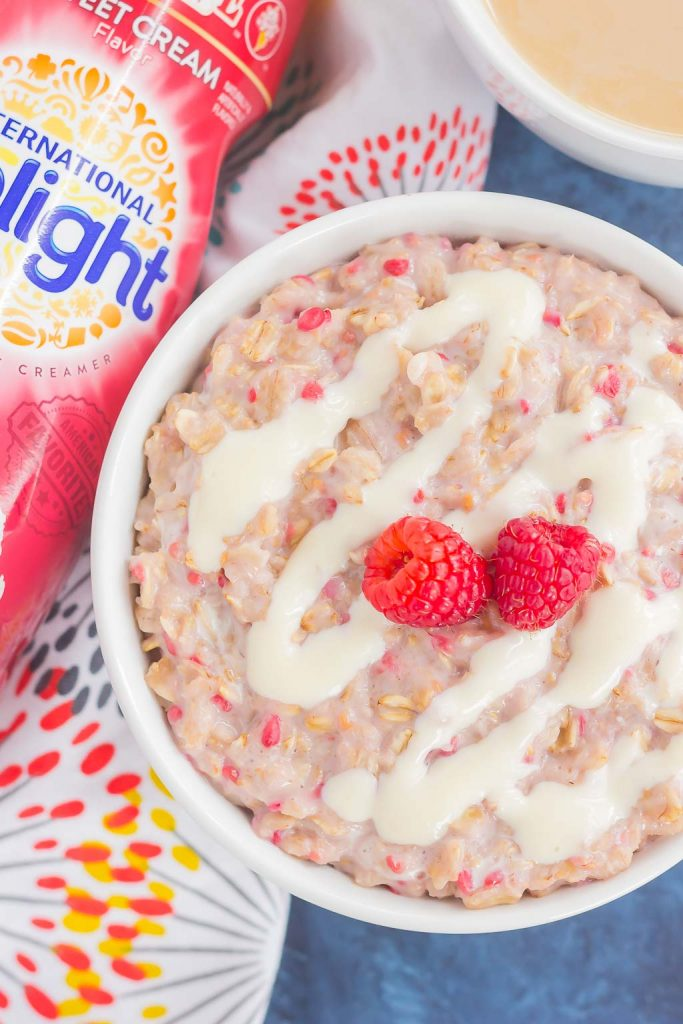 This simple and delicious Raspberry Cheesecake Swirl Oatmeal features hearty oats, fresh raspberries, and a swirl of creamy cheesecake. Easy to make, full of flavor, and on the healthier side, dessert for breakfast never tasted so good!