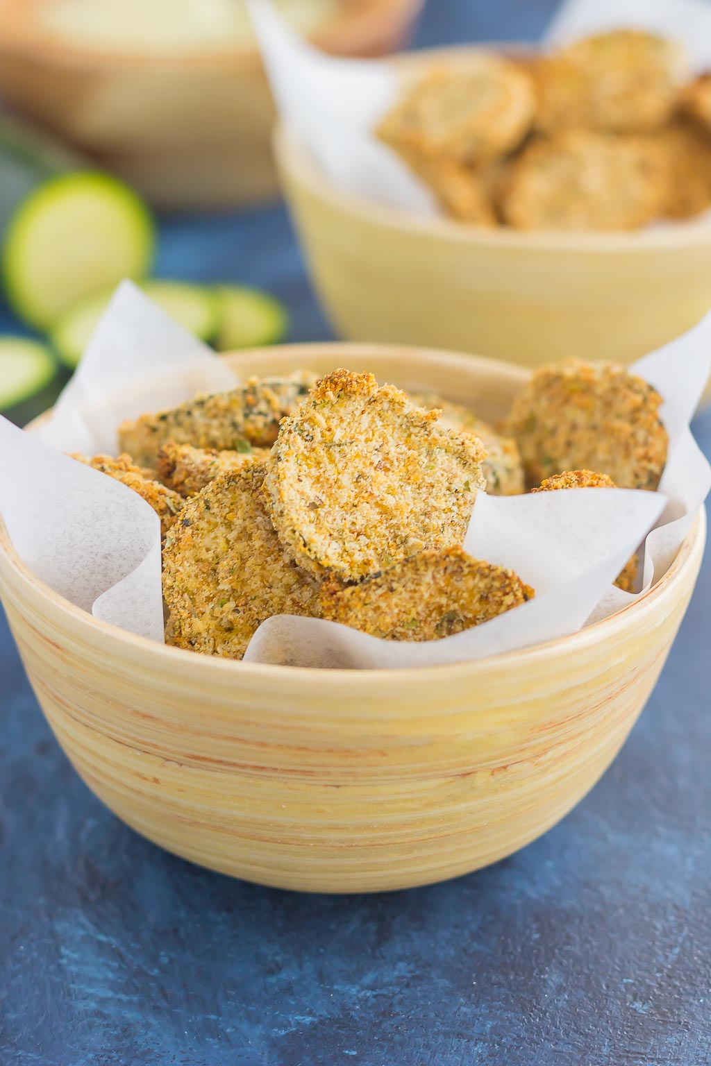 two bowls of baked zucchini chips