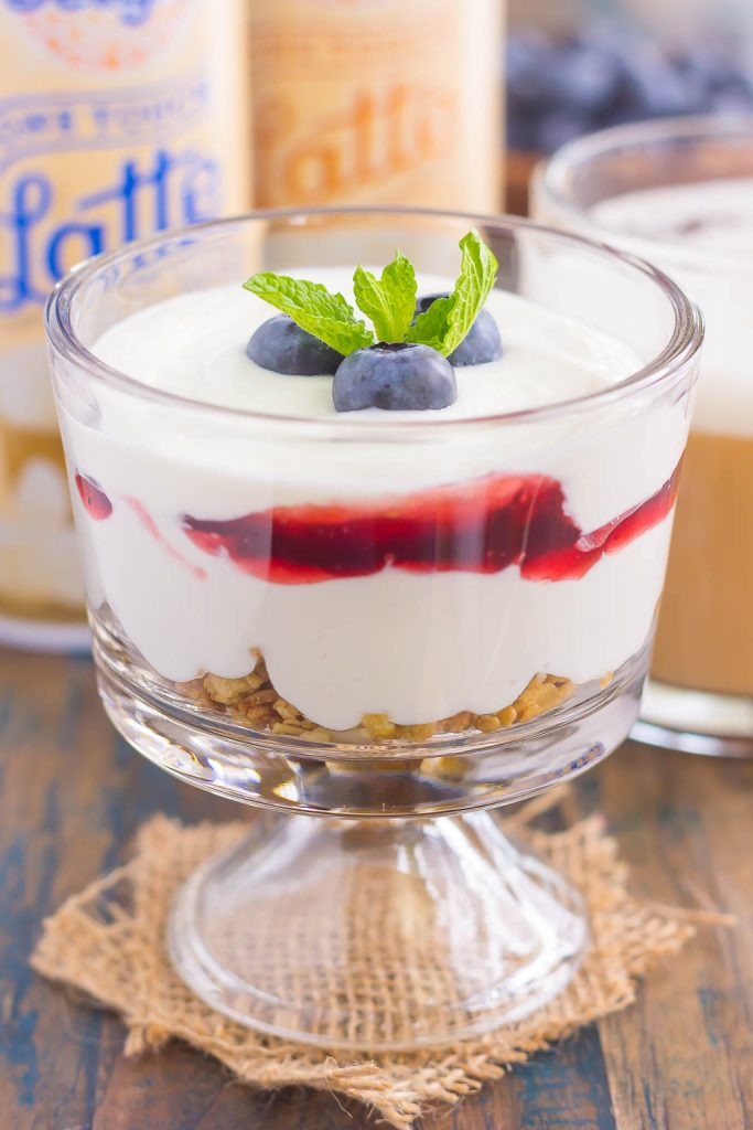 This Blueberry Cheesecake Breakfast Parfait is the best way to start the day. Vanilla Greek yogurt is infused with cream cheese and then layered with blueberries for the ultimate parfait. Light, creamy, and packed with flavor, this easy breakfast or snack is perfect for everyone!