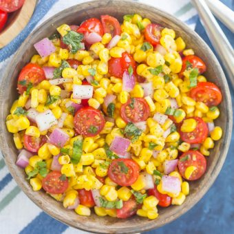 With fresh corn cut straight from the cob, cherry tomatoes, spices, and a light dressing, this Corn and Tomato Salad is perfect for a summer lunch or dinner!