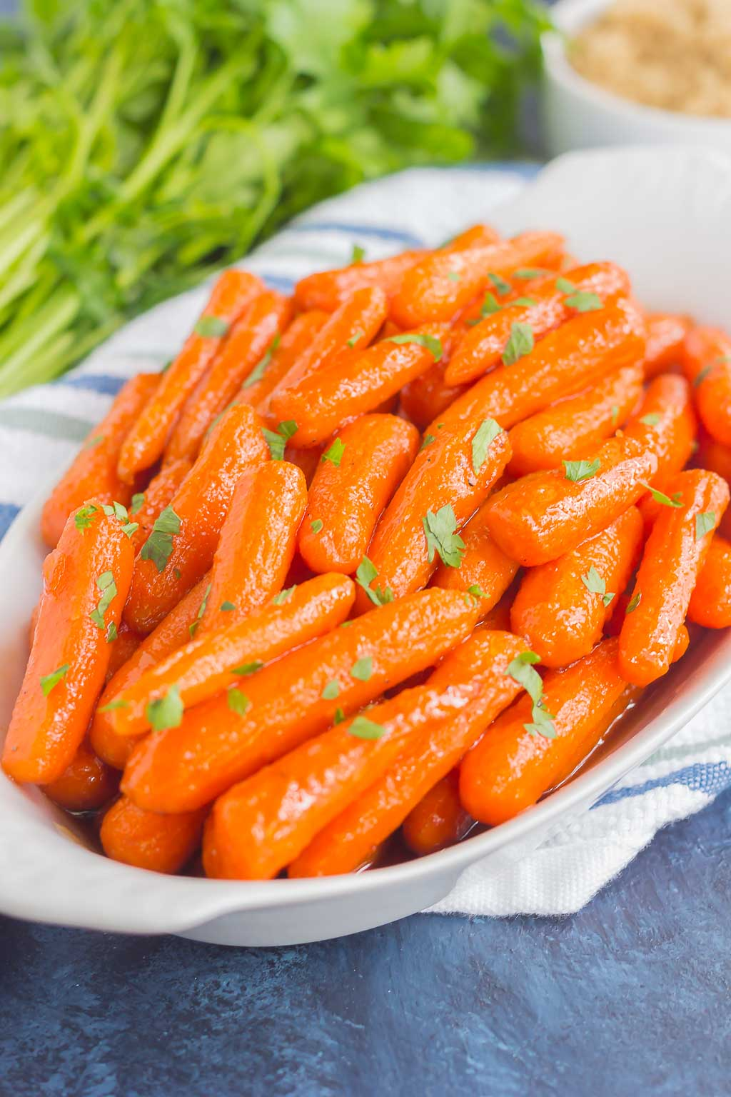These Maple Brown Sugar Glazed Carrots are simple to prepare and full of warm flavors. The brown sugar and maple syrup creates a sweet glaze that coats the carrots with a welcoming taste!