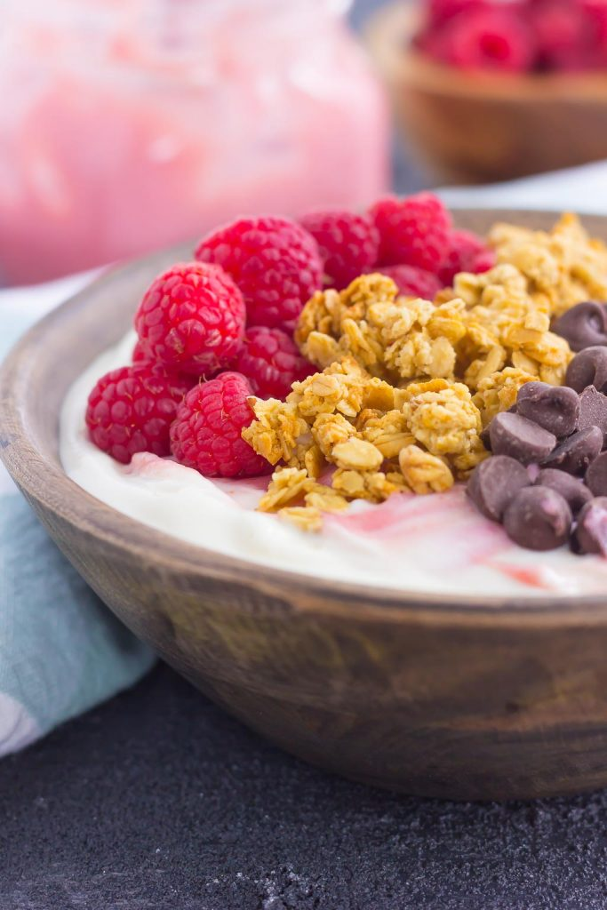 This Raspberry Grapefruit Yogurt Bowl is a delicious way to start the day. It's packed with creamy vanilla Greek yogurt, a swirl of raspberry grapefruit curd, and topped with a combination of sweet ingredients. Fresh, flavorful, and light, this is the best way to switch up your breakfast or snack routine!