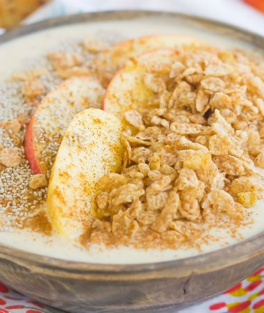 This Apple Cinnamon Smoothie Bowl is a delicious way to cure those breakfast or snack cravings. Filled with good-for-you ingredients and topped with cinnamon cereal, apples, and granola, this bowl is easy to make and bursting with flavor!