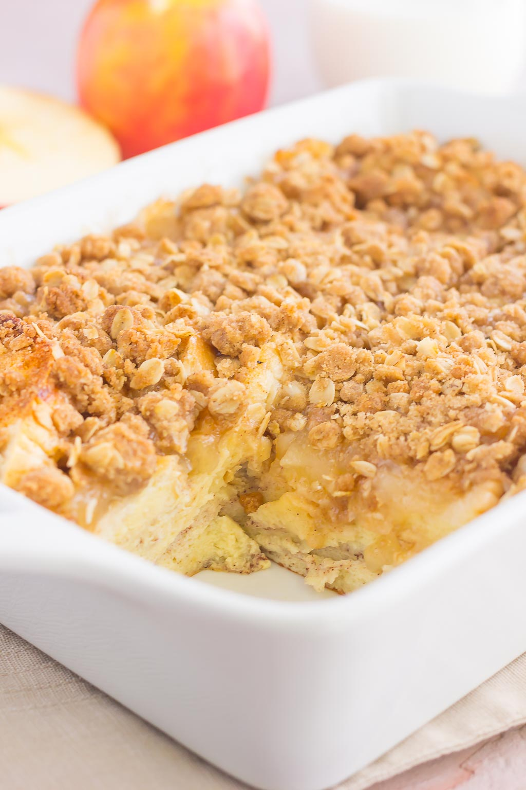 This Apple Pie French Toast Bake is an easy, make-ahead breakfast that captures the flavor of fall. Filled with slices of french bread, sweet apple pie filling, and topped with a crispy streusel, this dish is perfect for everyone to enjoy!