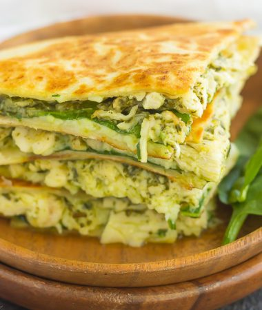 These Chicken and Spinach Pesto Quesadillas are simple to make and ready in less than 20 minutes. Filled with shredded chicken, pesto, baby spinach, and mozzarella cheese, this easy dish is packed with flavor and perfect for busy weeknights!