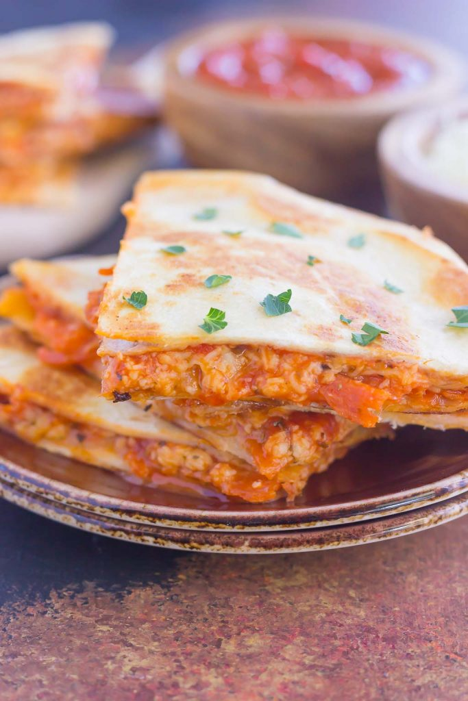 Perfect for a Friday night or anytime that want a quick meal, these Easy Pizza Quesadillas are sure to become a regular on your meal rotation! #pizza #quesadillas #pizzaquesadillas #pizzarecipes #pizzaappetizers #appetizer #snack #recipe
