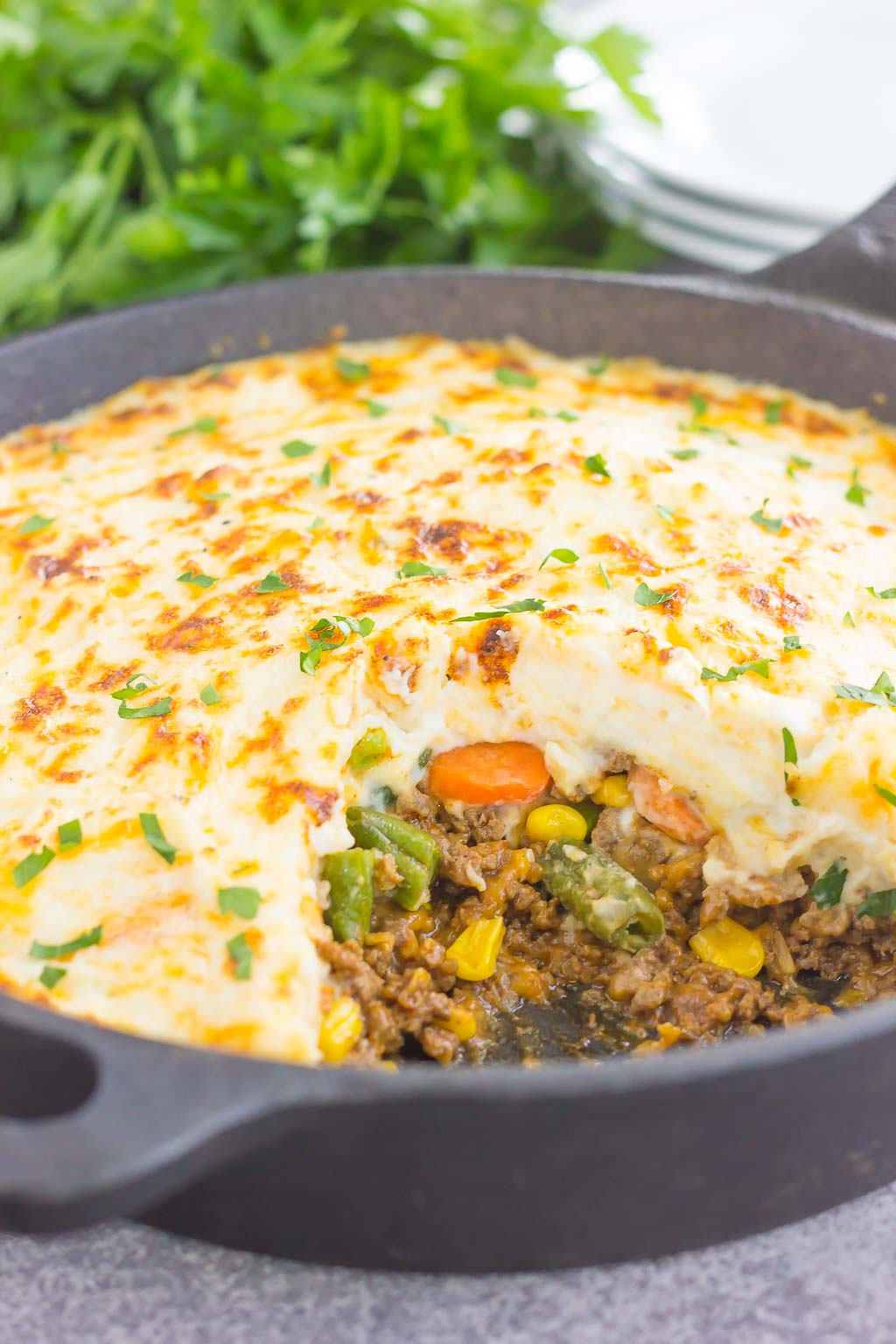 This Easy Shepherd's Pie features a unique spin on the classic version and is ready in less than 20 minutes. Loaded with zesty ground beef, cheddar cheese, mixed veggies, and topped with creamy, cheesy mashed potatoes, this is the ultimate comfort dish for everyone to enjoy!