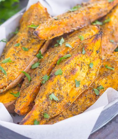 These Garlic Herb Sweet Potato Wedges are loaded with flavor and baked until crispy and golden. Made with just a few simple ingredients and ready in no time, these wedges are the perfect side dish for just about any meal!