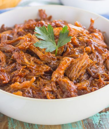 This Slow Cooker Barbecue Pulled Pork is made with just a few ingredients, almost no prep work, and makes the most delicious meal!