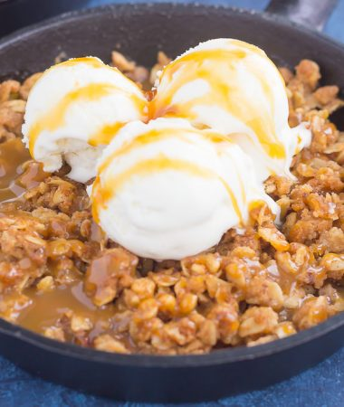 caramel apple crisp with vanilla ice cream on top
