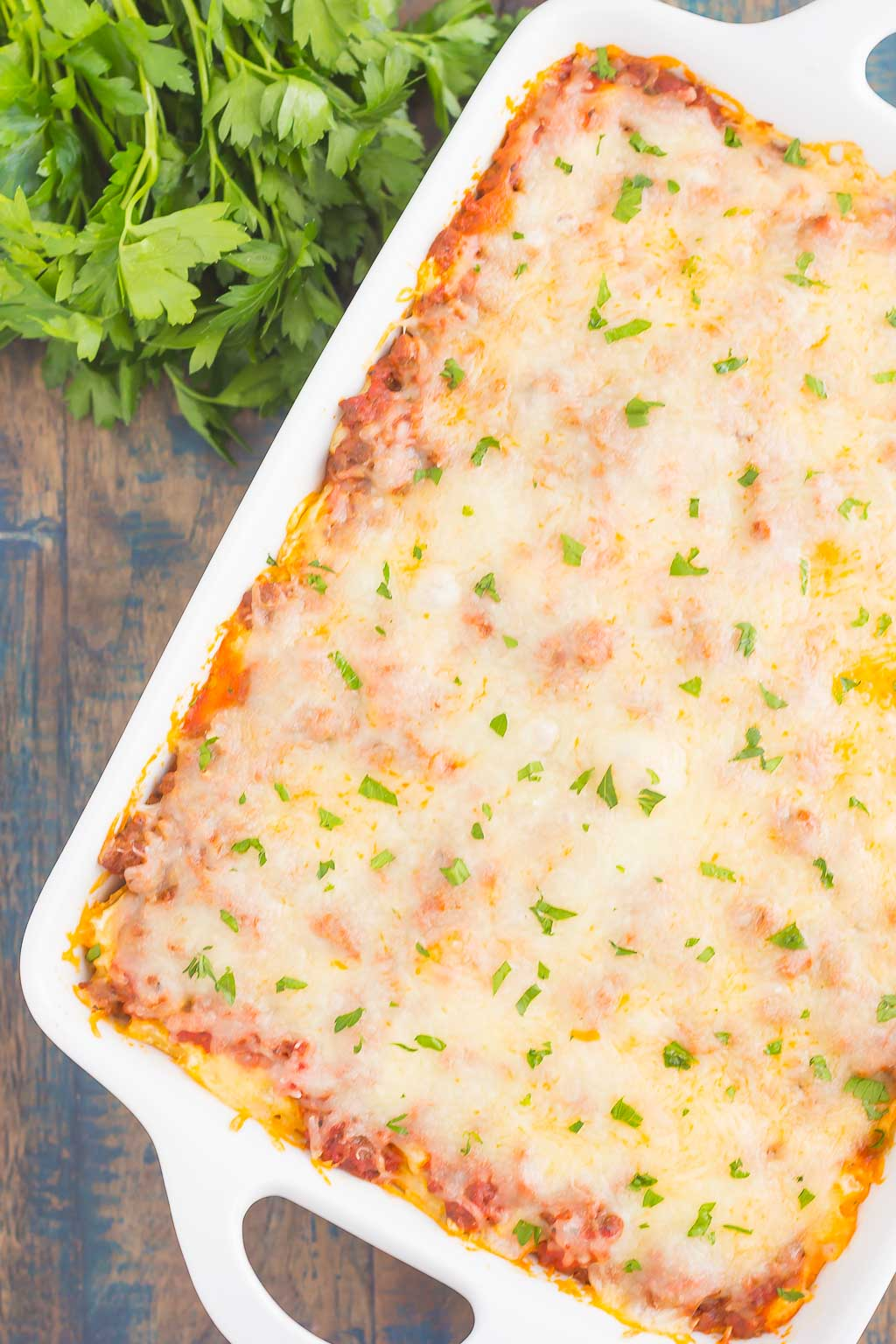 This Easy Baked Ziti is made with simple ingredients, full of flavor, and ready in less than an hour. Loaded with an easy meat sauce, tender pasta, and three types of cheese, this comfort dish is sure to be a dinnertime crowd-pleaser!