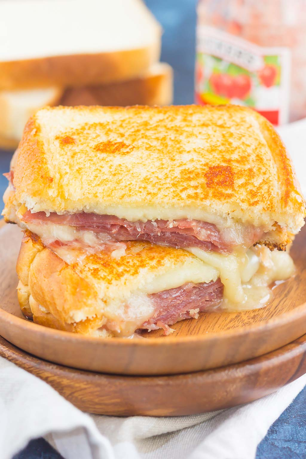 This Prosciutto, Raspberry and Brie Grilled Cheese is loaded with fresh slices of prosciutto, raspberry jam, brie and mozzarella cheeses. Grilled until golden and melty, this sandwich is the perfect comfort dish! #grilledcheese #grilledcheeserecipe #sandwich #prosciuttosandwich #prosciuttogrilledcheese #briegrilledcheese #maindish #lunch