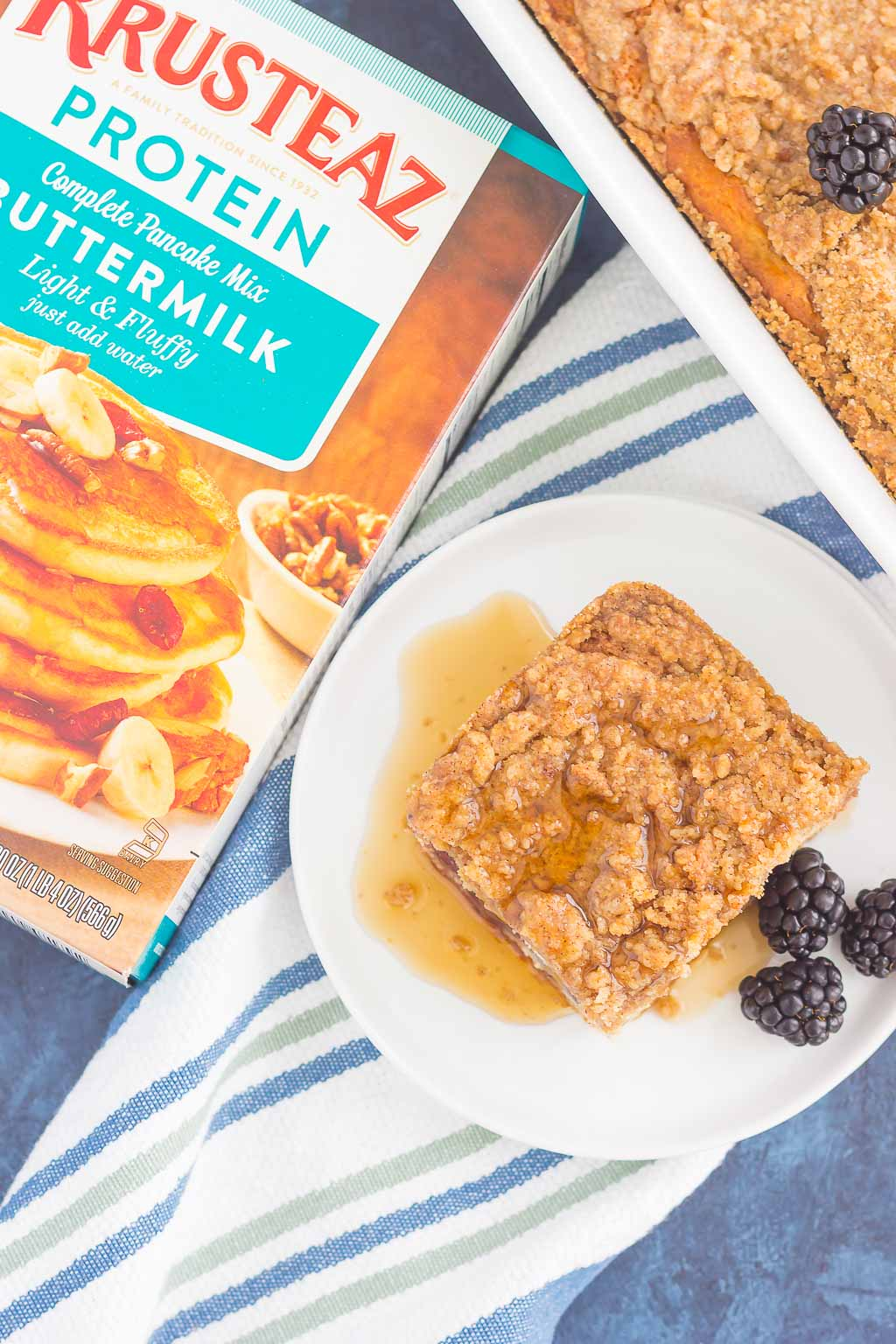This Blackberry Streusel Pancake Casserole is an easy dish that the whole family will enjoy. Fluffy, buttermilk pancake batter is studded with fresh blackberries and then topped with cinnamon streusel. Baked until golden and bursting with flavor, this comfort dish is the ultimate breakfast!