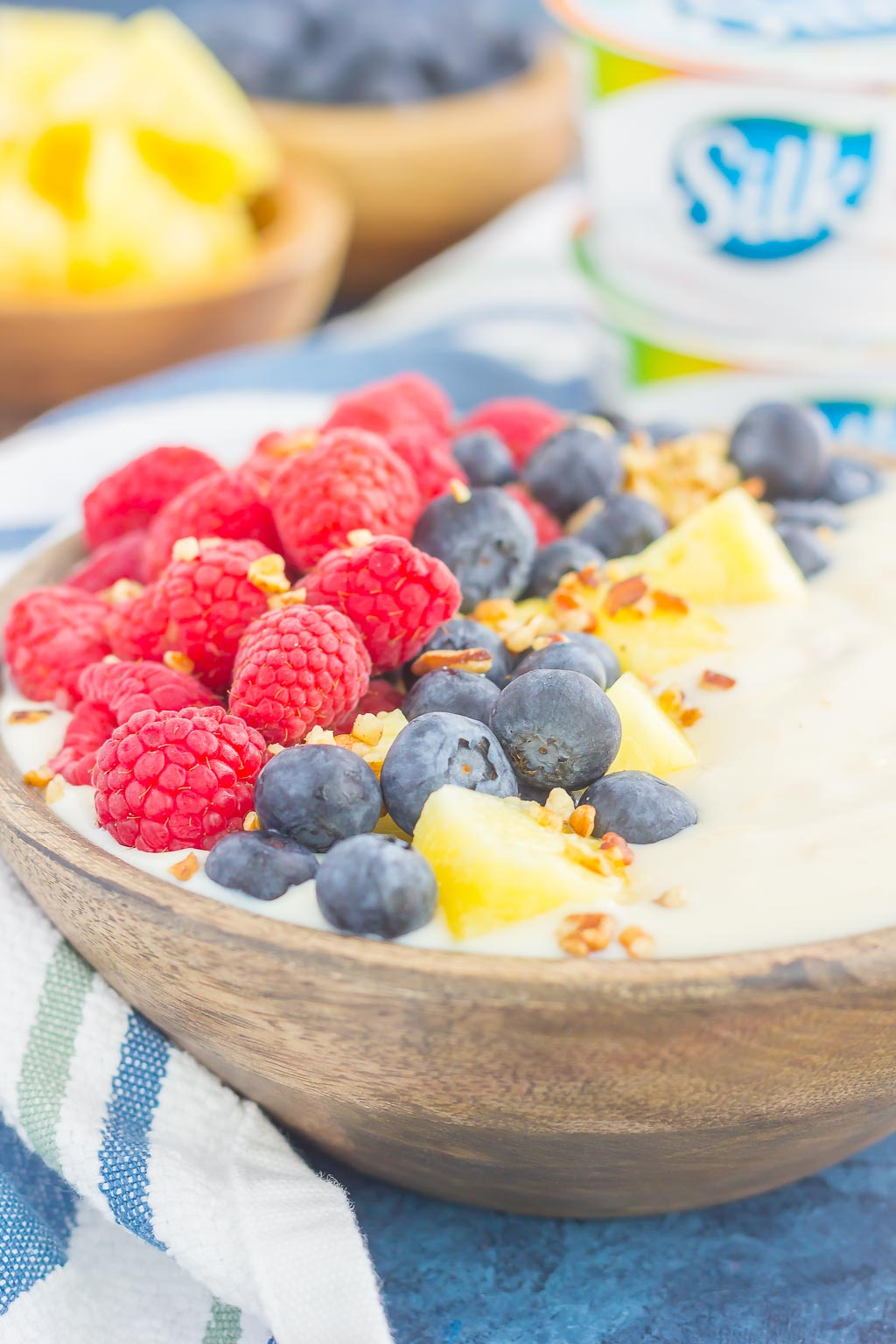 This Fruity Peach Yogurt-Alternative Bowl is a deliciously sweet way to start the day. Packed with Silk® Peach & Mango Dairy-Free Yogurt Alternative, fresh fruit, and a sprinkling of chopped pecans, this bowl is ready in minutes and makes the perfect breakfast!