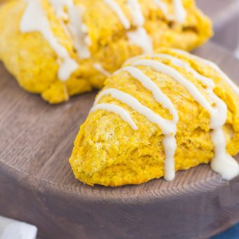 These Pumpkin Scones with Maple glaze are flaky, soft, and buttery. The edges bake up crisp, while the insides are tender and bursting with pumpkin flavor. Topped with an irresistibly sweet maple glaze, these easy scones make the perfect breakfast or dessert!