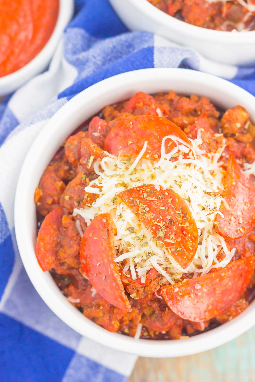 Overhead view of slow cooker no bean pizza chili in a white ramekin.