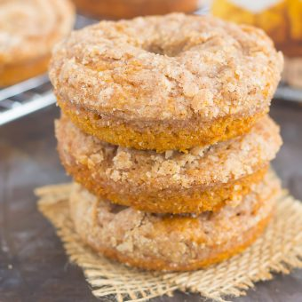 These Baked Pumpkin Streusel Donuts are soft, fluffy, and bursting with pumpkin. Filled with cozy fall flavors and topped with a sweet cinnamon streusel, this easy treat is the perfect fall breakfast or dessert!
