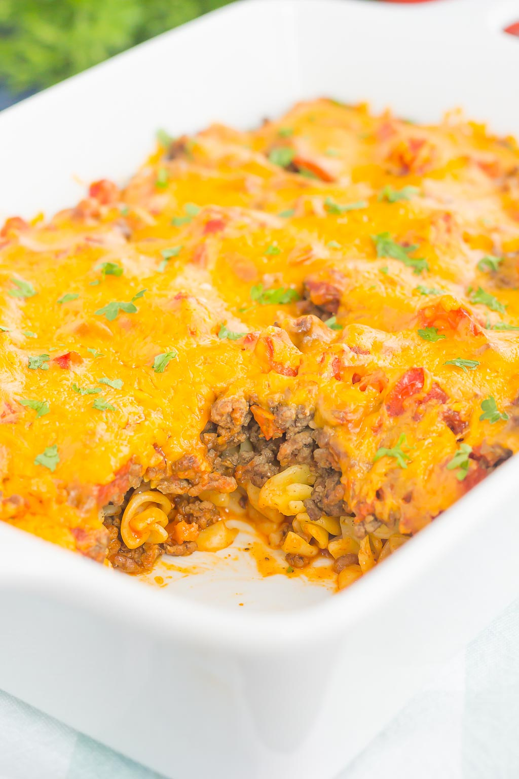 cheeseburger casserole in casserole dish with serving missing