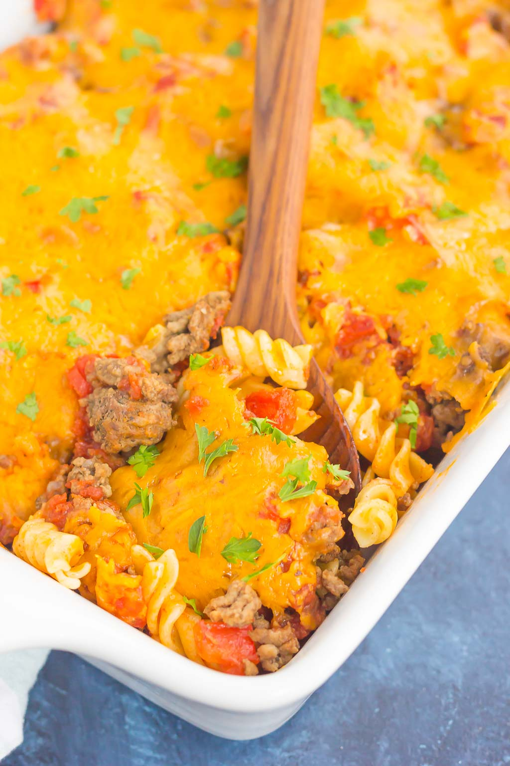 This Cheeseburger Casserole is loaded with the flavors of a classic cheeseburger, but in comfort food form. Tender pasta, seasoned ground beef, and a sprinkling of spices and cheese make this dish a family favorite for dinner!