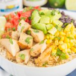 Skip the takeout and make your own Easy Chicken Burrito Bowl at home! It's loaded with juicy chicken, cilantro lime rice, black beans, corn, fresh tomatoes, and avocado. Drizzled with a soy sauce marinade and ready in no time, this meal is sure to become a family favorite!