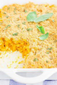 pumpkin mac and cheese in a white baking dish