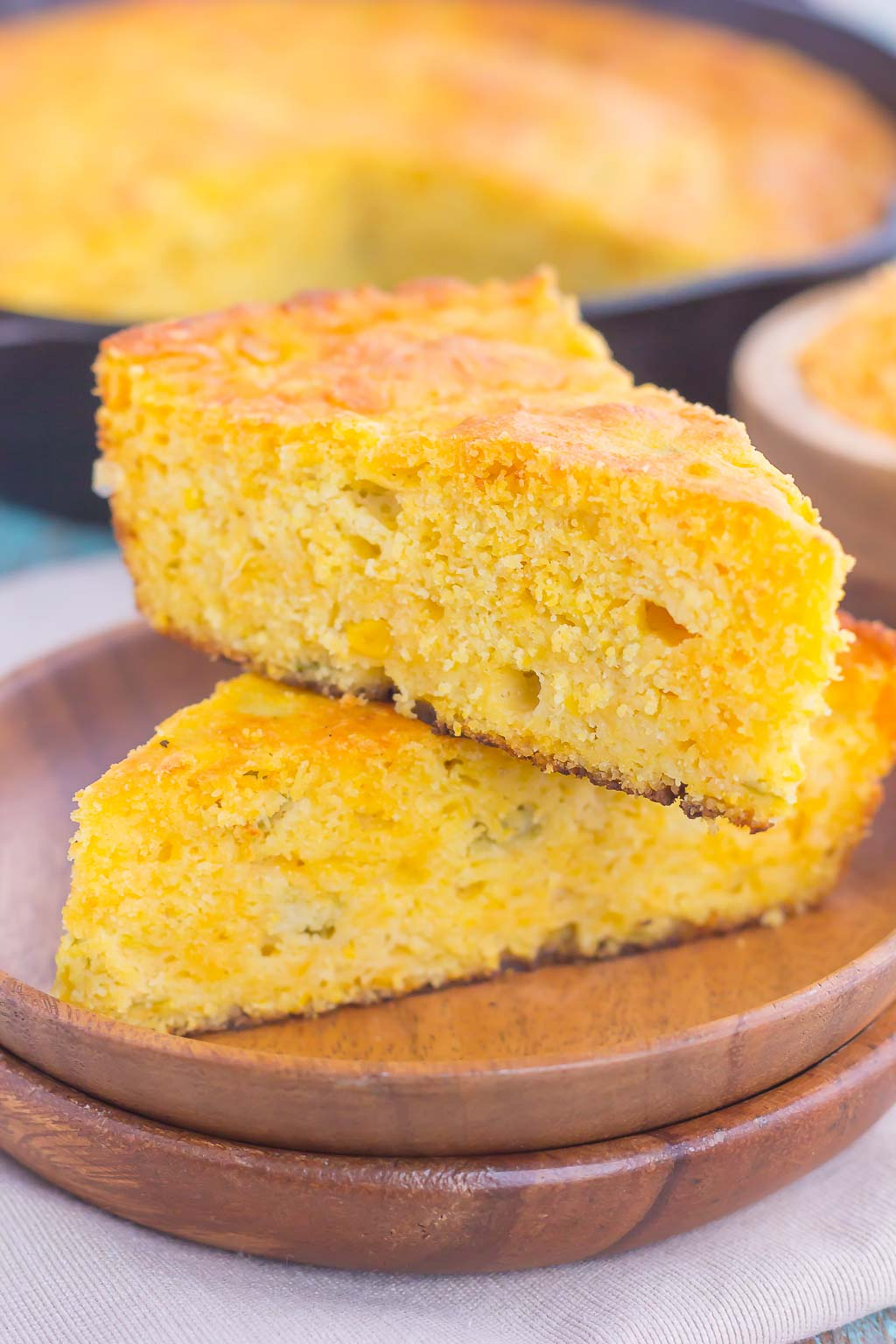 This Southwest Skillet Cornbread is the perfect combination of sweet and spicy that will be a favorite for years to come. Loaded with cheddar cheese, green chiles, and creamed corned, this easy cornbread bakes up moist, tender, and full of flavor! #cornbread #cornbreadrecipe #skilletcornbread #southwestcornbread #breadrecipe
