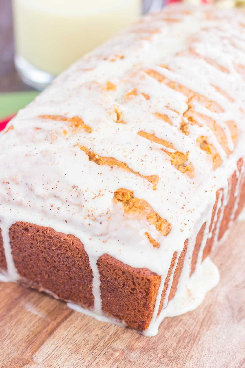 This Glazed Eggnog Bread is filled with warm holiday spices and makes a deliciously festive treat. Soft, moist and bursting with a subtle hint of eggnog, you'll love the flavors of this bread that would make a decadent breakfast or dessert!
