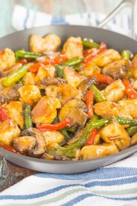 honey garlic chicken stir-fry in a pan
