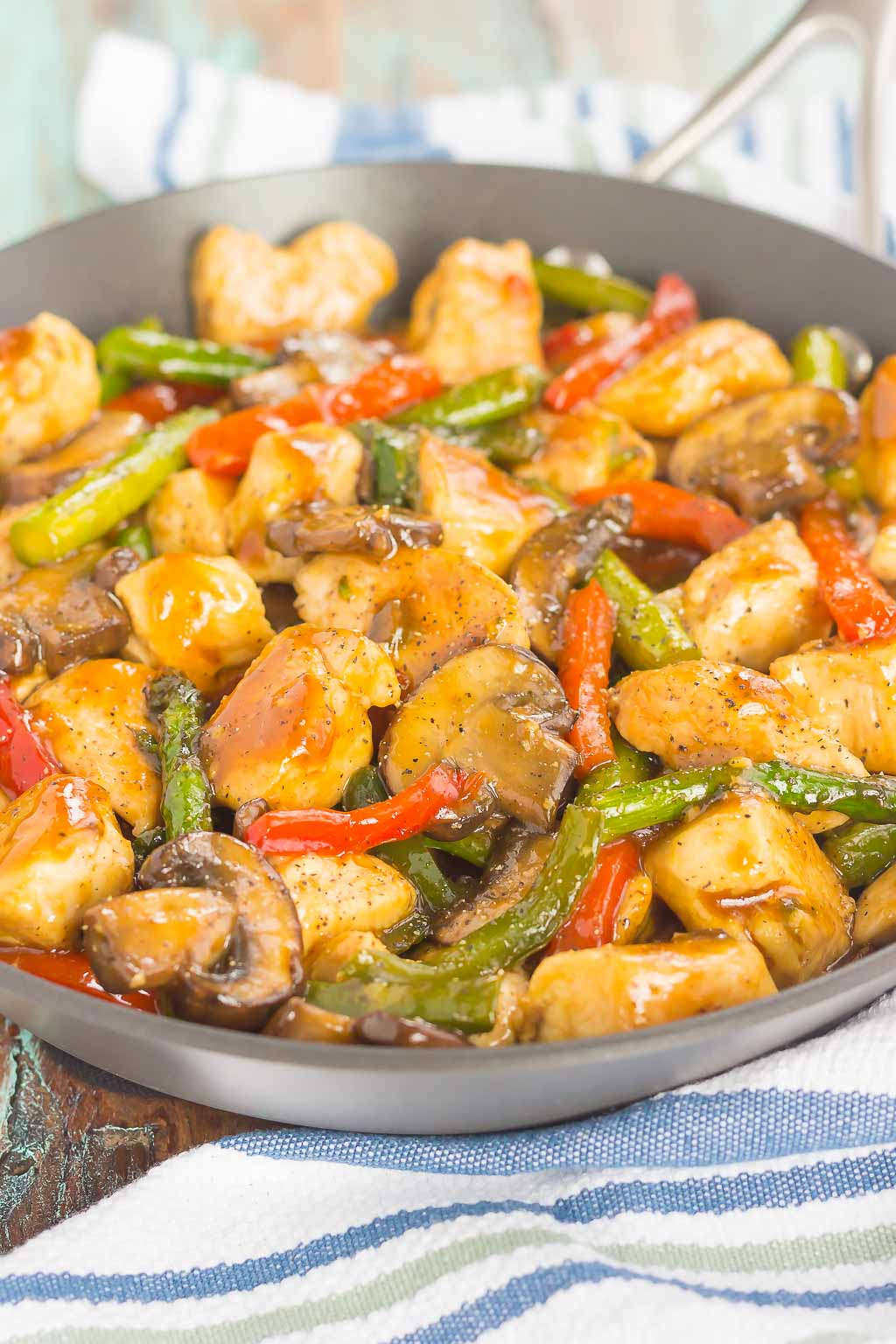This Honey Garlic Chicken Stir-Fry is an easy, one pan meal that's ready in just 30 minutes. Fresh veggies and chicken are tossed in a sweet and savory sauce that's seasoned to perfection. This simple meal is a dish that the whole family will enjoy!