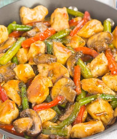 an easy chicken stir-fry with veggies in a pan
