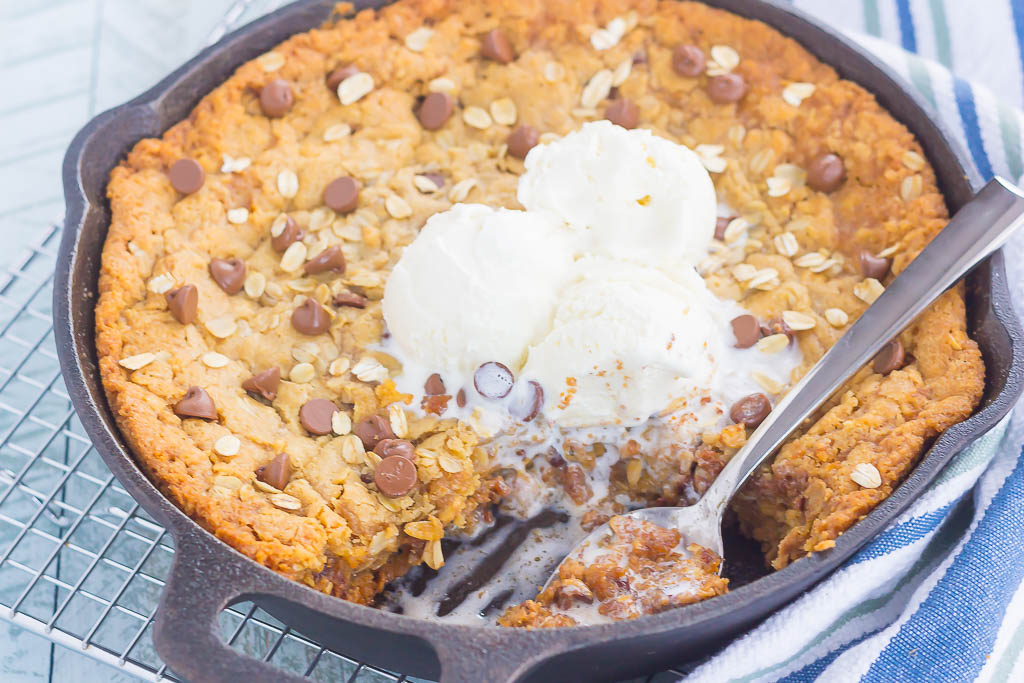 You won't be able to resist this warm, thick, and fudgy Peanut Butter Chocolate Chip Skillet Cookie. Packed with creamy peanut butter, hearty oats, and chocolate chips, this cookie is packed with flavor and is perfect when served with a big scoop of vanilla ice cream!