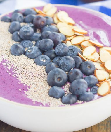This Blueberries and Cream Smoothie Bowl is just what you need to get you going in the morning. Packed with sweet blueberries, Greek yogurt, and healthier ingredients, this thick and creamy smoothie bowl is loaded with flavor and all of the fun toppings!