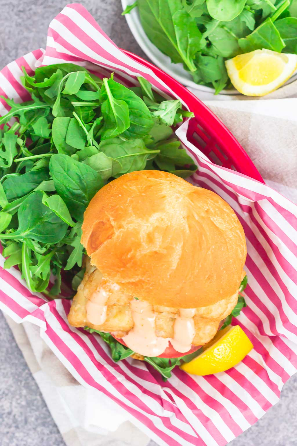 This Crispy Fish Sandwich with Sriracha Mayo is an easy weeknight meal that's loaded with flavor. Crispy, beer-battered fillets are nestled on a toasted bun and topped with a creamy sriracha mayonnaise. Fast, fresh, and simple to make, this easy dinner is ready in less than 30 minutes!