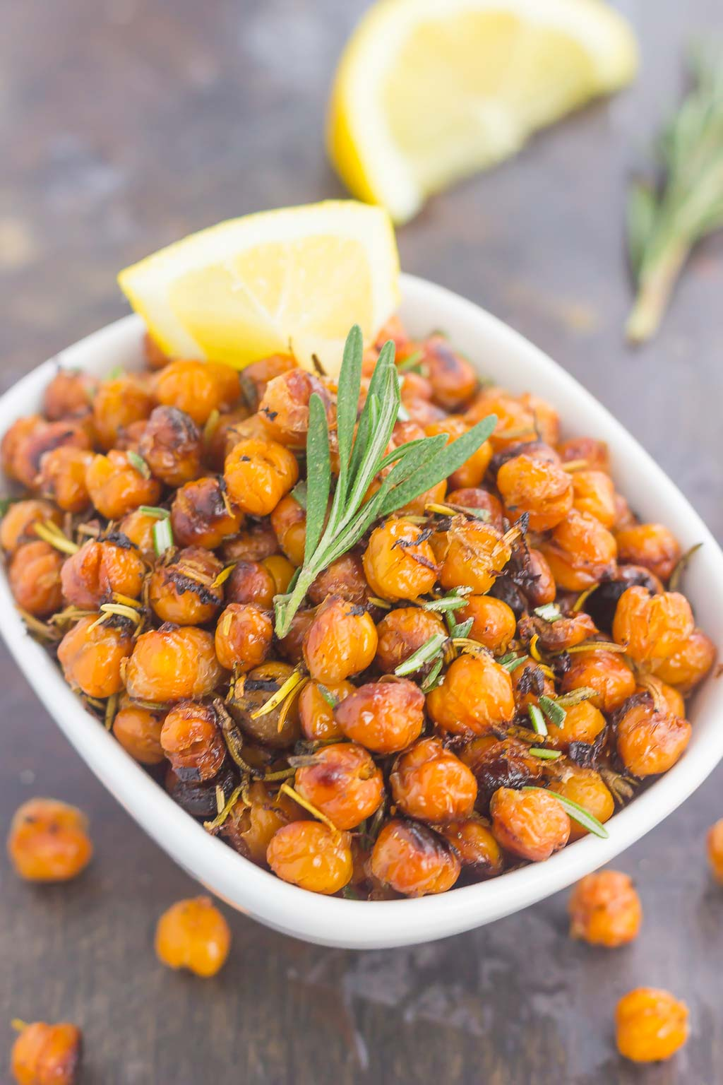 These Roasted Lemon Rosemary Chickpeas make a delicious snack or great addition to salads or soups. Packed with tangy lemon and fresh rosemary, these crunchy chickpeas are easy to make and perfect for when the munchies strike!