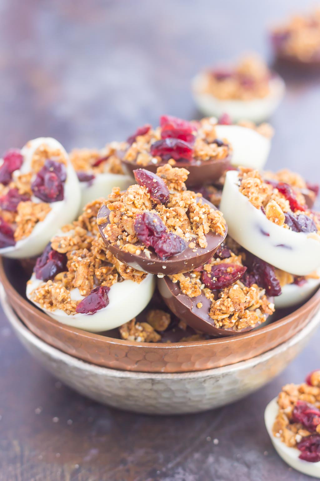 These Chocolate Cherry Granola Cups are the perfect bite for when you want something sweet. Smooth dark chocolate and creamy white chocolate cups are topped with crunchy granola and dried cherries. With no oven needed and ready in minutes, these cups make a delicious dessert or snack!