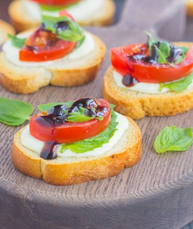 Caprese Bites make an easy appetizer that's ready in minutes. Fresh basil, mozzarella cheese, ripe tomatoes and a drizzle of balsamic glaze top toasted bread slices for the perfect bite. If you love caprese flavors, then this simple snack was made for you!